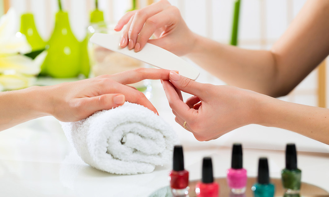 Woman In A Nail Salon Receiving A Manicure By A Beautician; Shutterstock ID 154608623; PO: Today.com